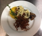 Grilled Polenta with seared crimini mushrooms, smoked gouda and parmesan crisp
